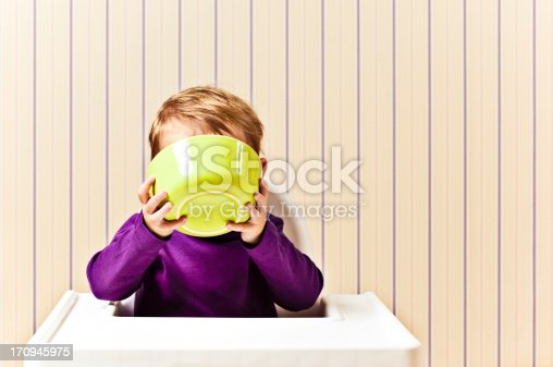 istock Little Girl drinking from cereal bowl 170945975