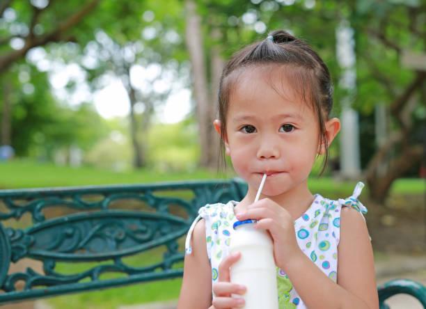 Little girl drinking milk with straw in the park picture id836450766?b=1&k=6&m=836450766&s=612x612&w=0&h=olte g r tmbp0vvvprs9owh5c6hq8anr2ne8g22dwm=