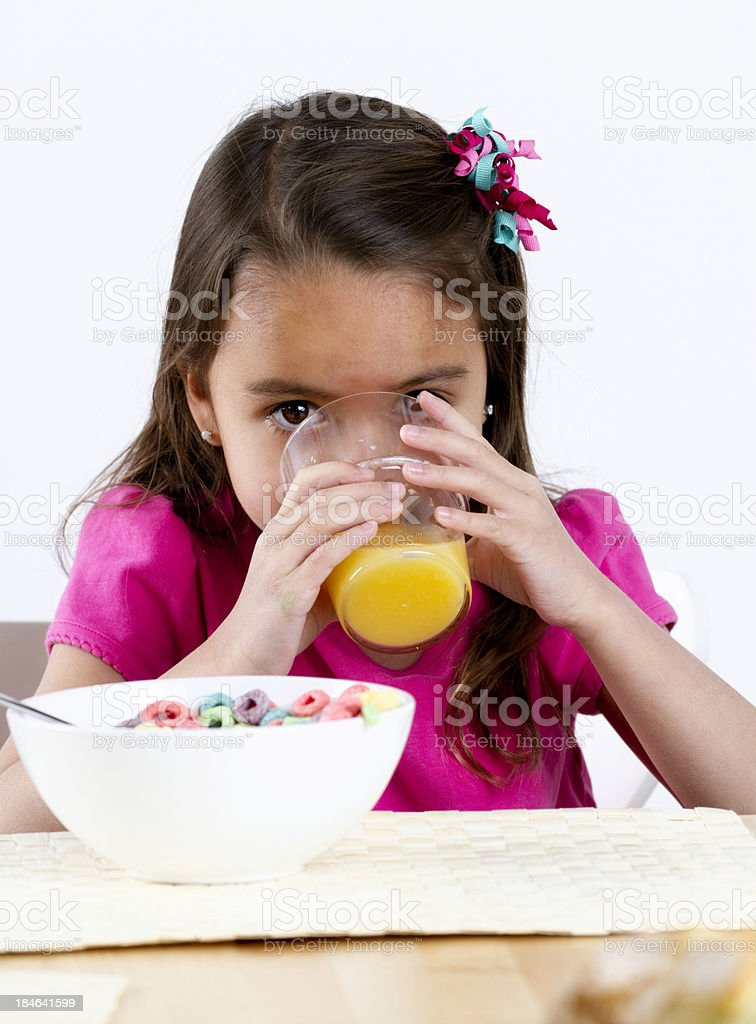 Little Girl Drinking Orange Juice royalty-free stock photo