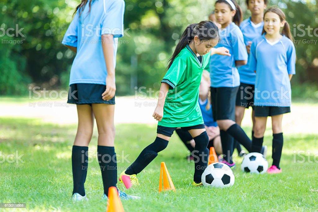 Little girl during soccer practice stock photo
