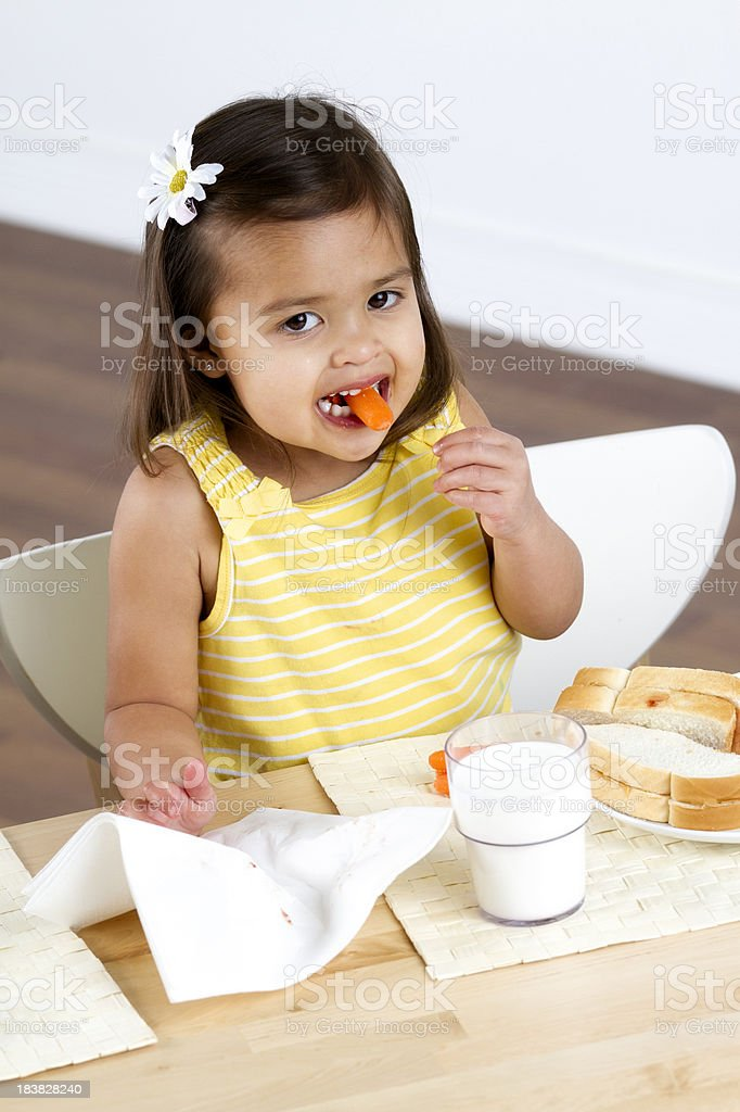 Little Girl Eating a Carrot royalty-free stock photo