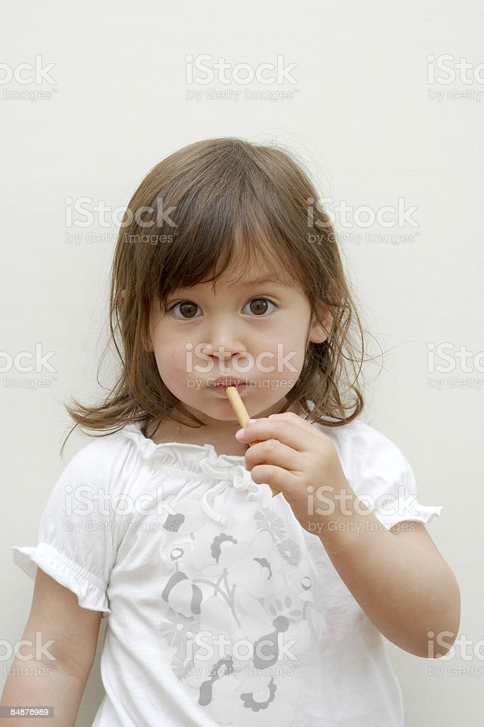 little girl eating a snack royalty-free stock photo