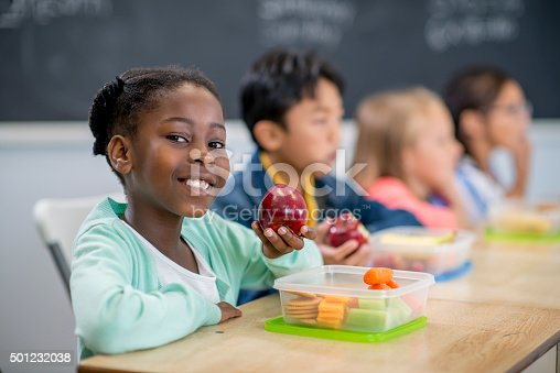 istock Little Girl Eating an Apple in Class 501232038