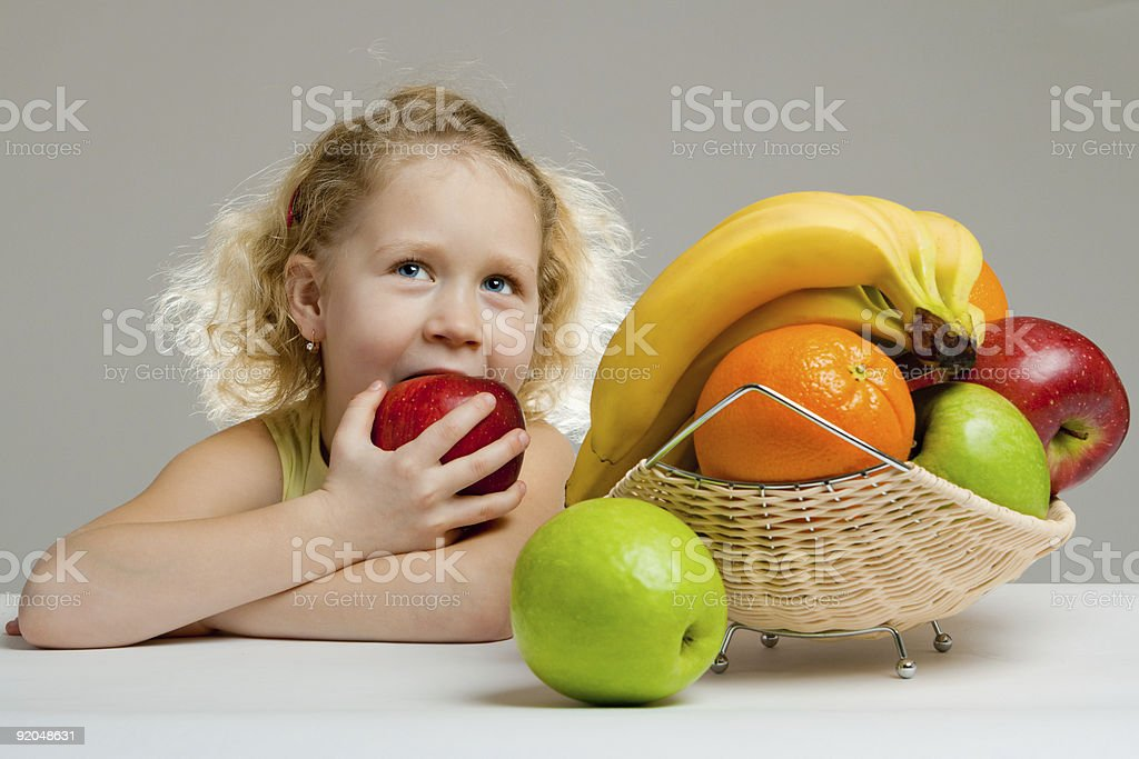 Little girl eating an apple royalty-free stock photo