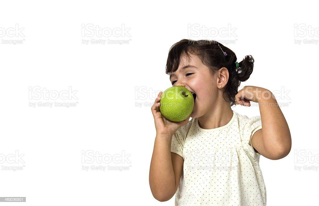 little girl eating apple stock photo