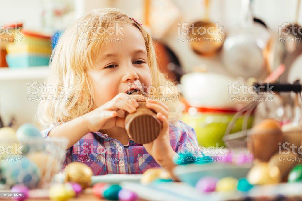 Little Girl Eating Chocolate Easter Bunny stock photo