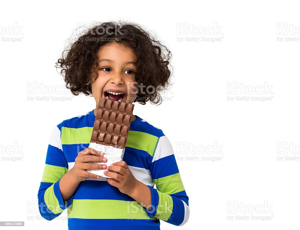 Little girl eating chocolate stock photo