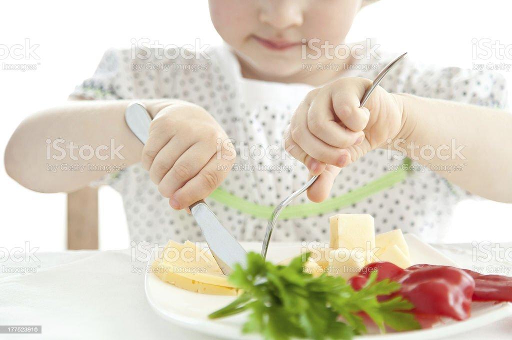 Little girl eating her dinner royalty-free stock photo