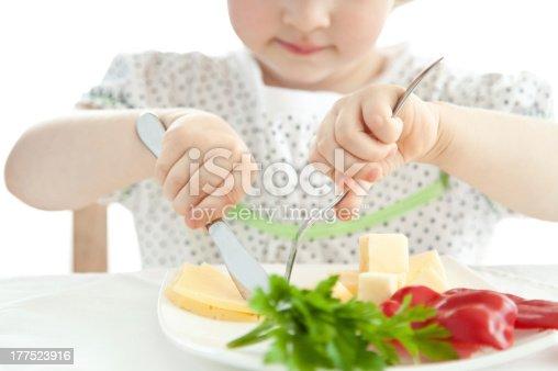 176993221istockphoto Little girl eating her dinner 177523916