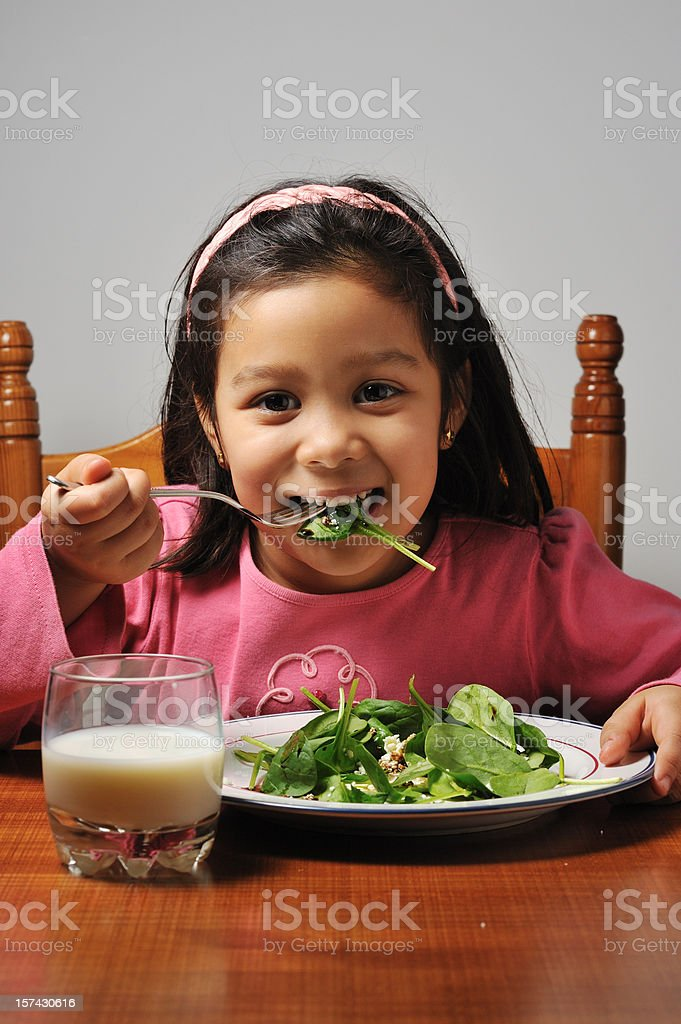 Little girl eating her greens royalty-free stock photo
