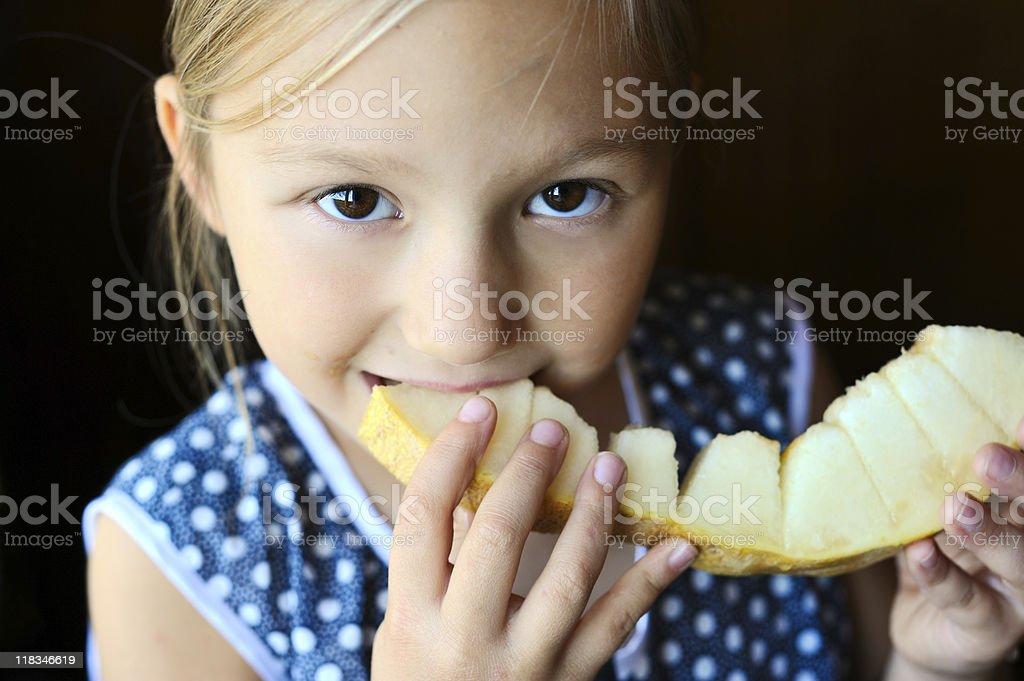 Little girl eating melon royalty-free stock photo