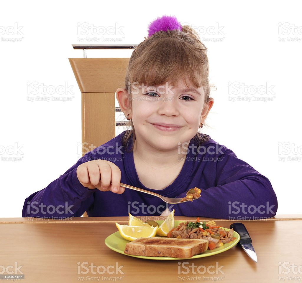 little girl eating royalty-free stock photo
