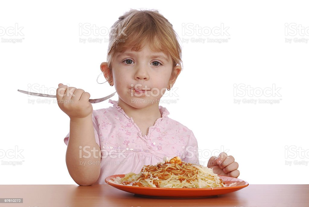 little girl eating spaghetti royalty-free stock photo