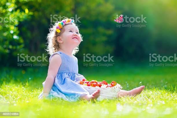 Little girl eating strawberry watching a butterfly picture id465524884?b=1&k=6&m=465524884&s=612x612&h= oqddewmx6qkkfafdvd4gwbu0nkevzpcdk5zaysxgt8=