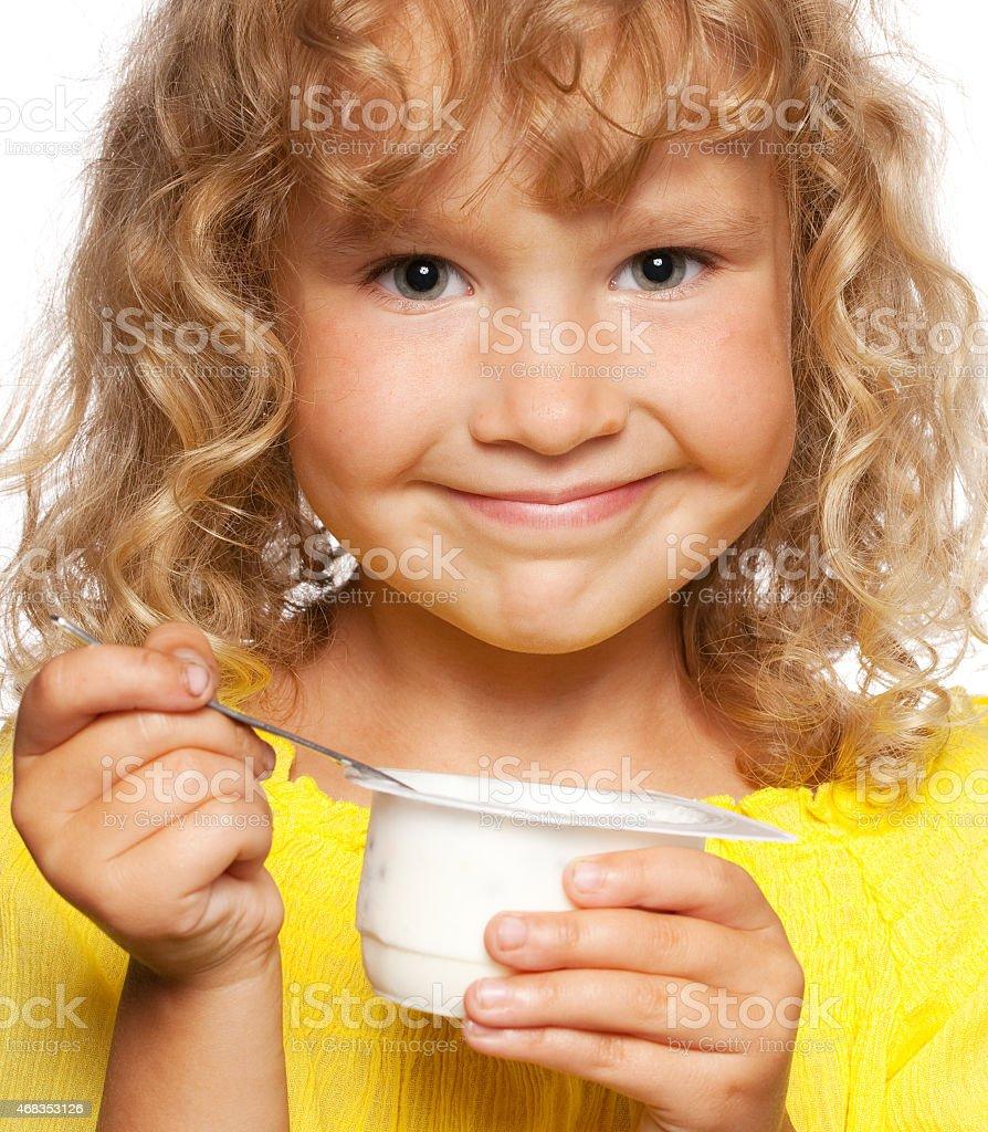 Little girl eating yogurt royalty-free stock photo