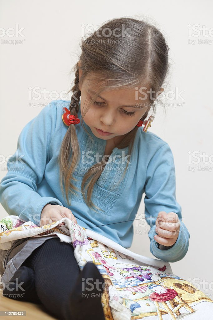 Little girl embroidering royalty-free stock photo