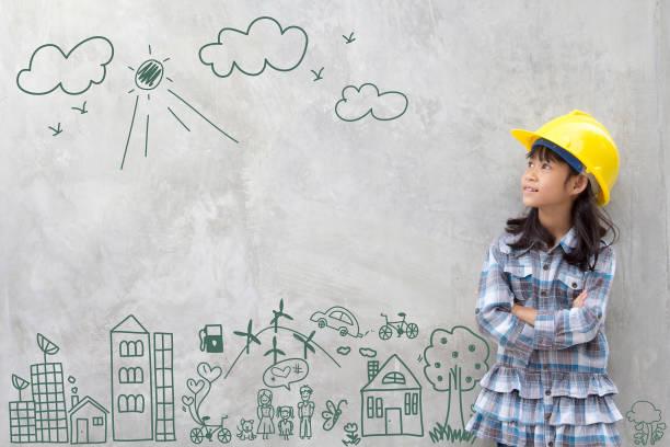 niña de la ingeniería con entorno de dibujo creativo con la feliz familia, medio ambiente, ahorrar energía, contra una pared de ladrillo - arquitecta fotografías e imágenes de stock