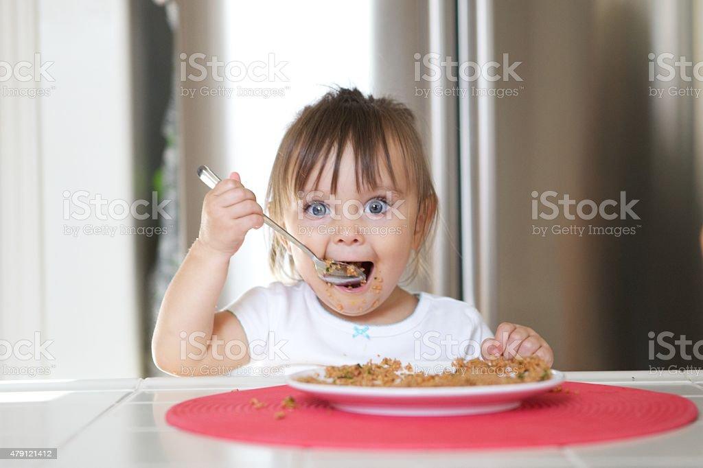 Little Girl Enjoying Her Pilav stock photo