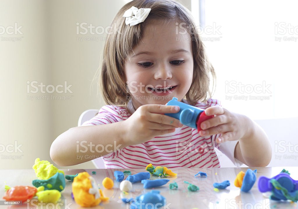 Little girl enjoying her playtime with playdoh royalty-free stock photo