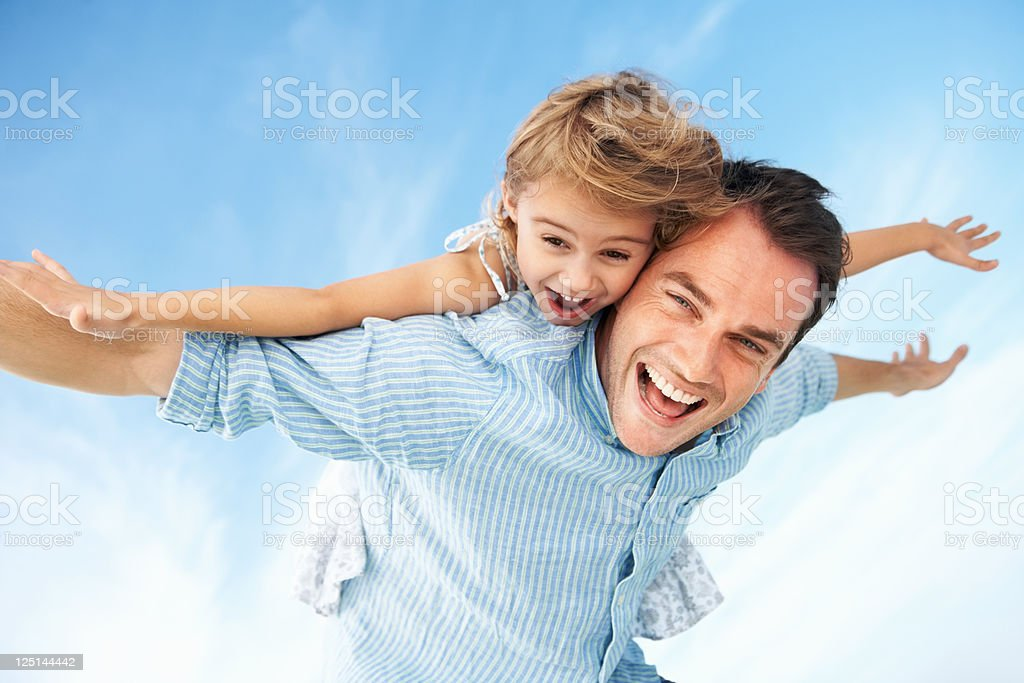 Little girl enjoying piggyback ride with father royalty-free stock photo