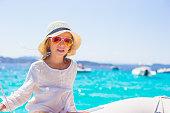 Adorable little girl enjoying sailing on yacht