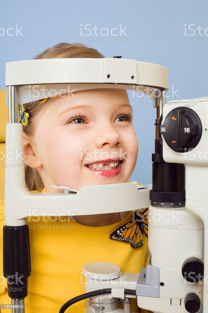 Little Girl Eye Exam Tonometer Close up of a little girl patient with a tonometer. 6-7 Years Stock Photo
