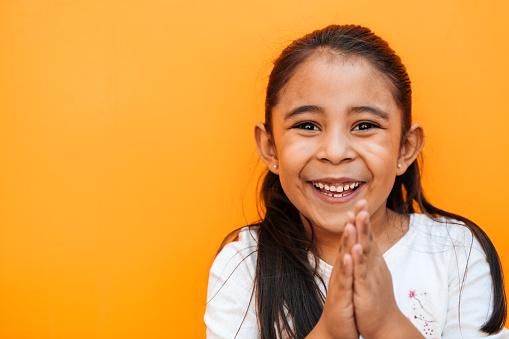 Portrait of a little girl praying