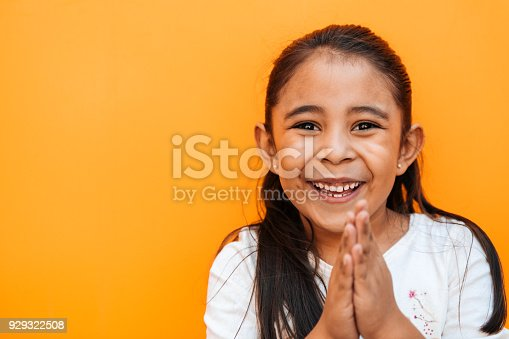 Portrait of a little girl praying