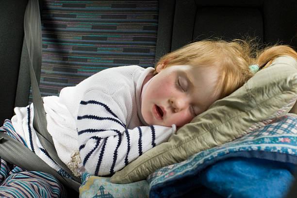Little girl fallen asleep on pillow stock photo