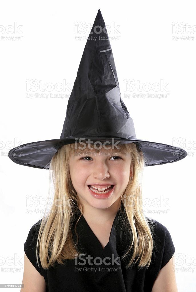 Little girl fancy dress as wicked witch with black hat royalty-free stock photo