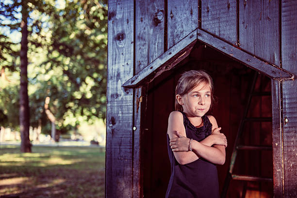 Little girl feeling cold Little girl standing in a shade and feeling cold goosebumps stock pictures, royalty-free photos & images