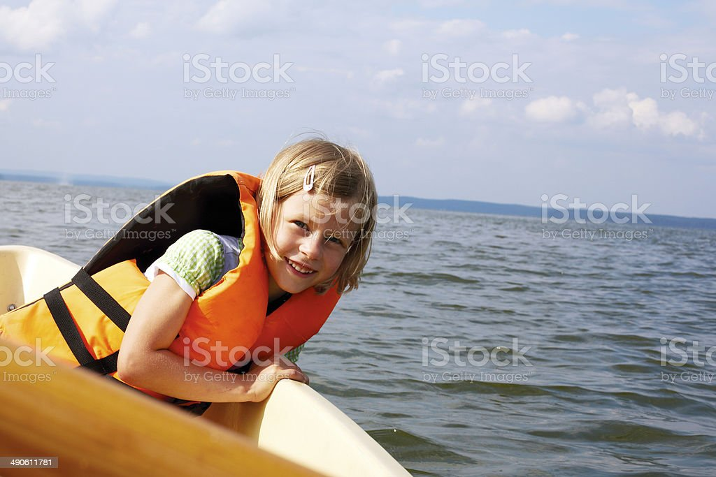 little girl floats in a boat stock photo