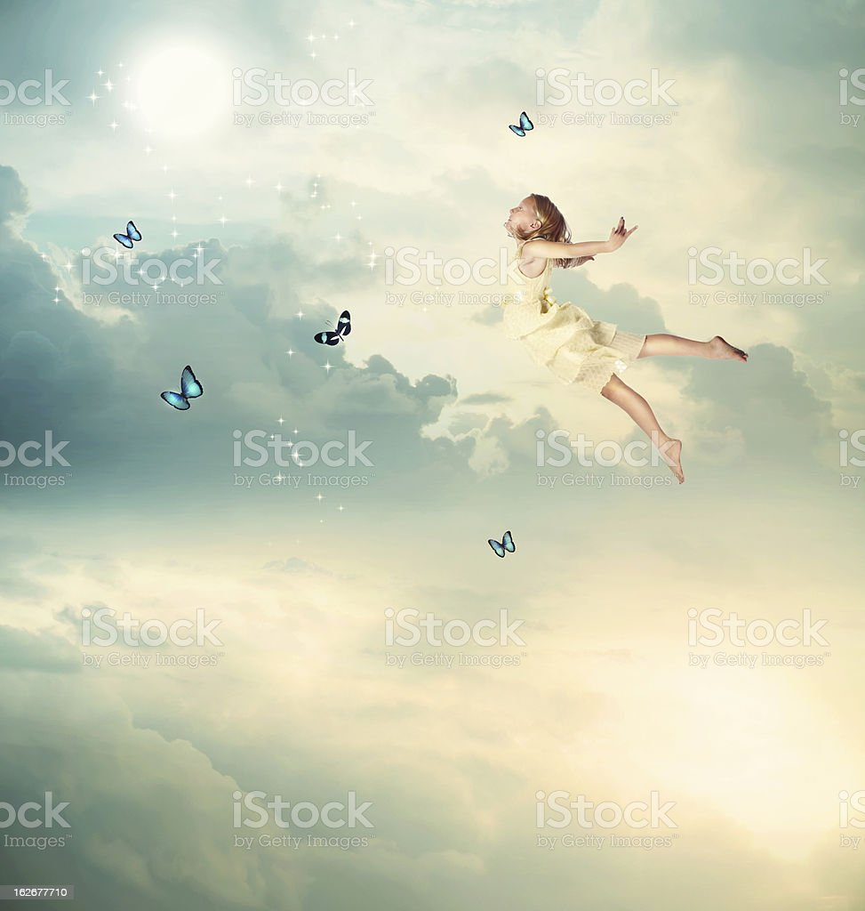 Little Girl Flying at Twilight royalty-free stock photo