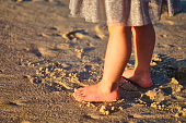 Footprints in the sand. The feet of the mother and child walk along the shore. Summer memories. Plzha by the sea. High quality photo