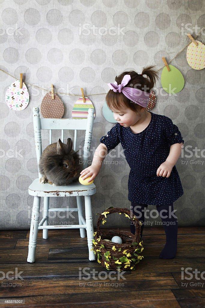 Little Girl Gathering Easter Eggs stock photo