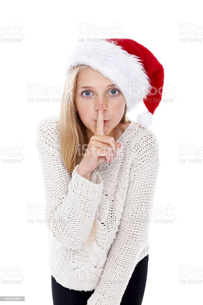 Little girl gesturing silence with her finger on lips royalty-free stock photo