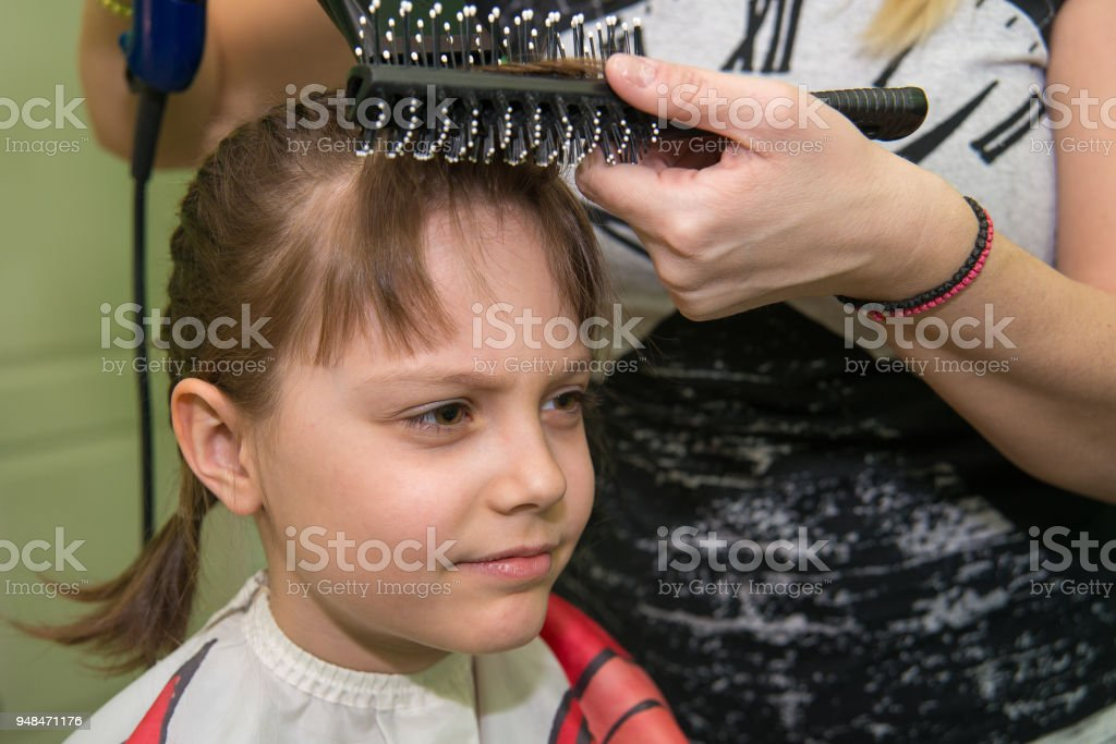 Little Girl Getting Haircut In Salon Stock Photo More Pictures Of