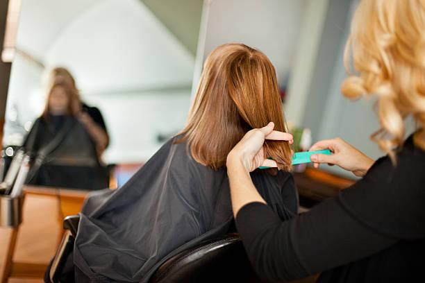 Little Girl Getting Haircut stock photo