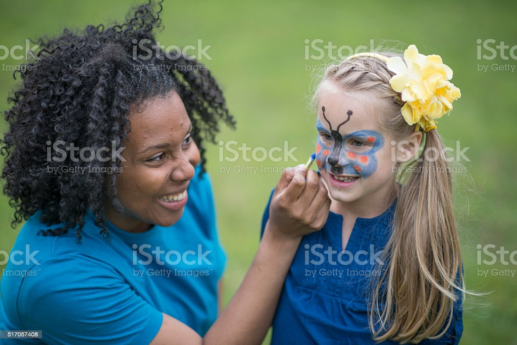 Little Girl Getting Her Face Painted stock photo