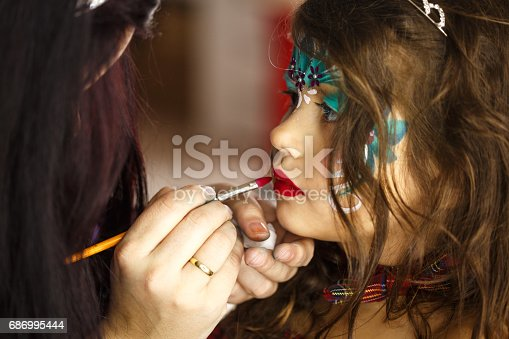 istock Little girl getting her face painted 686995444
