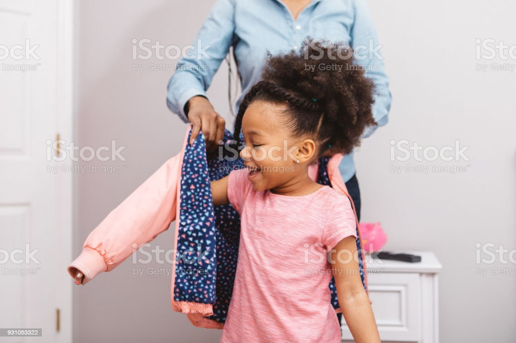 little girl getting ready for school stock photo