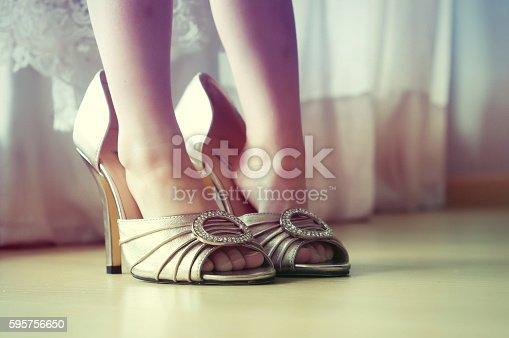 Little girl girl tries wedding shoes