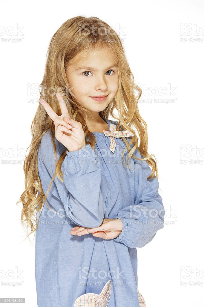 Little Girl Gives a Peace Sign royalty-free stock photo