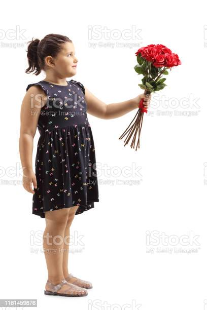 Little girl giving a bunch of red roses picture id1161459876?b=1&k=6&m=1161459876&s=612x612&h= 1uz2yn6h8vp v hu puj8yjvfuxqesfzllhw9fztda=