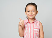 Little girl giving thumbs up