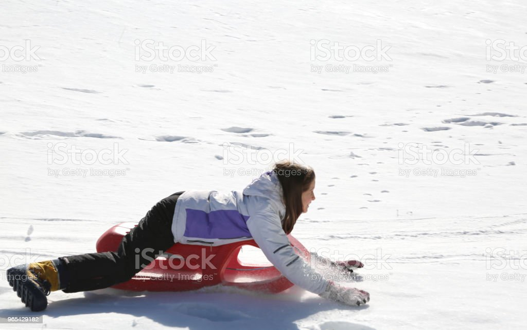 little girl goes down with the sled zbiór zdjęć royalty-free