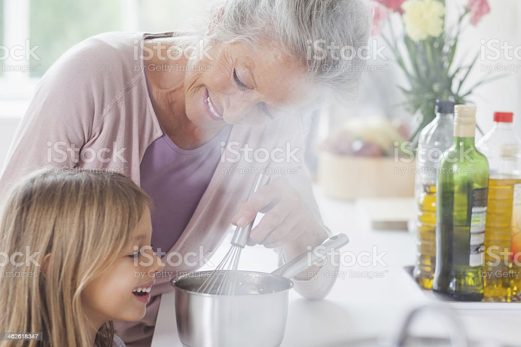Little girl happily looking at chocolate sauce royalty-free stock photo