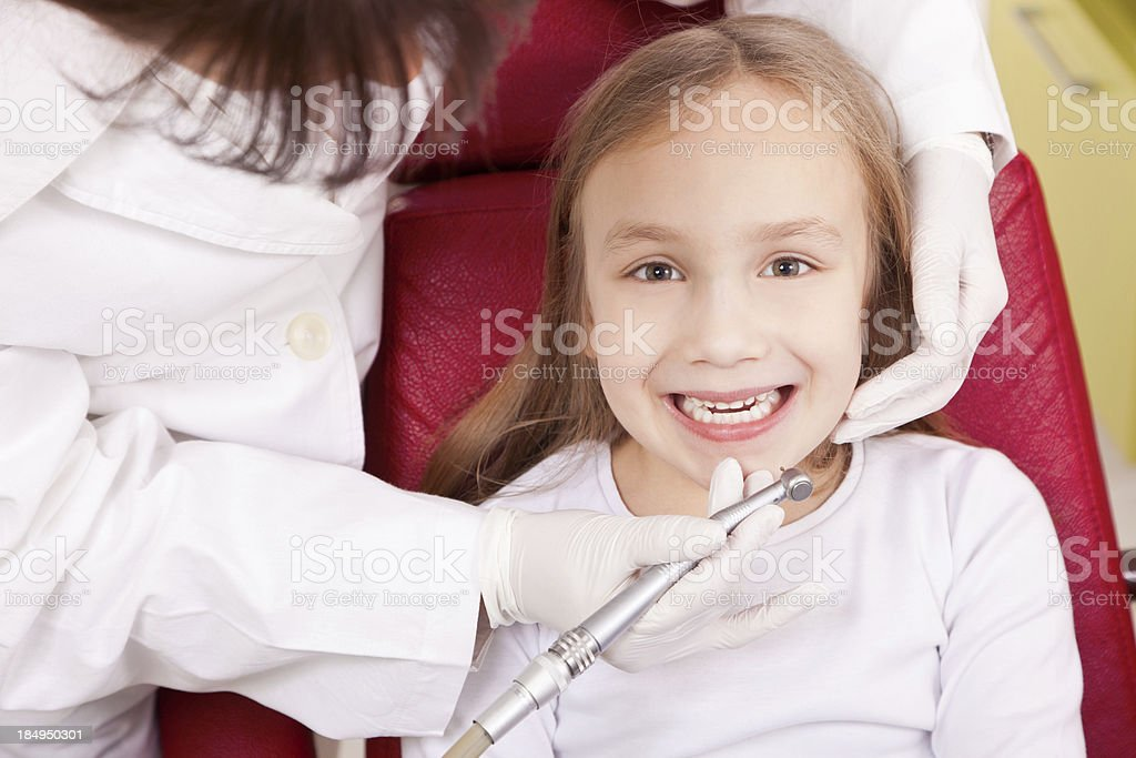 Little girl has her tooth repaired royalty-free stock photo