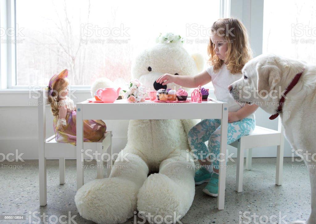 A little girl having a tea party stock photo