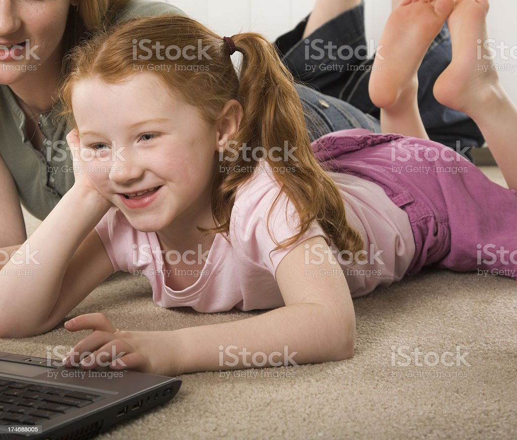little girl having computer fun royalty-free stock photo